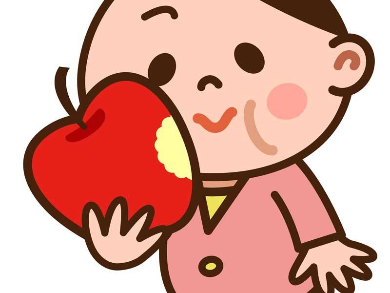 りんごを食べている妊婦さんのイラスト