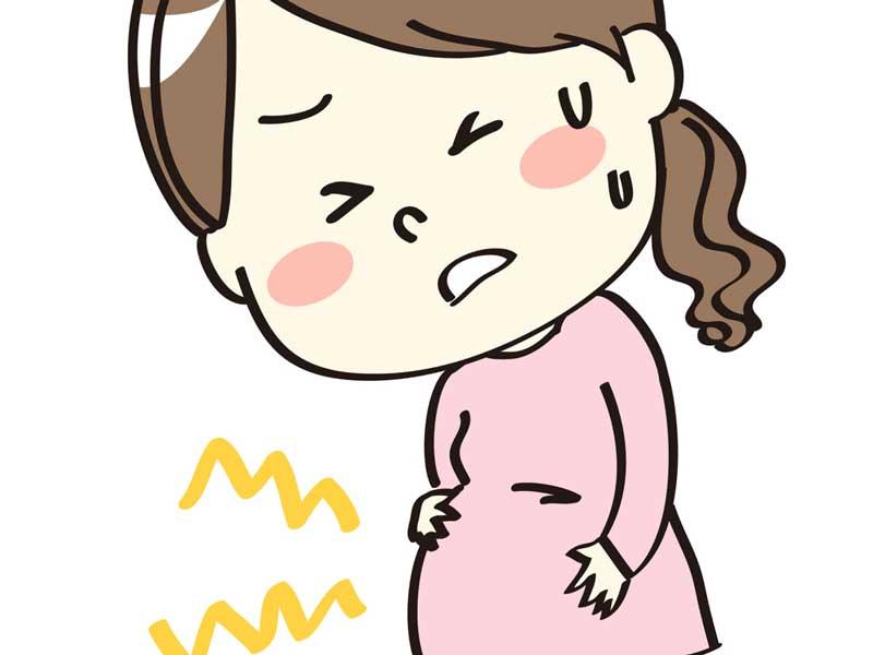 陣痛の痛みでお腹をおさえる妊婦さんのイラスト