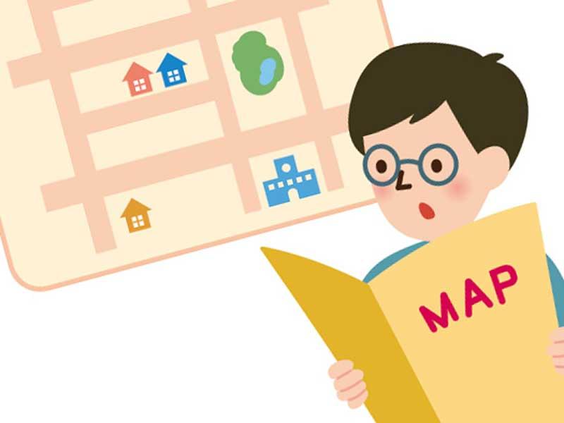 家の場所を地図で確認する先生のイラスト