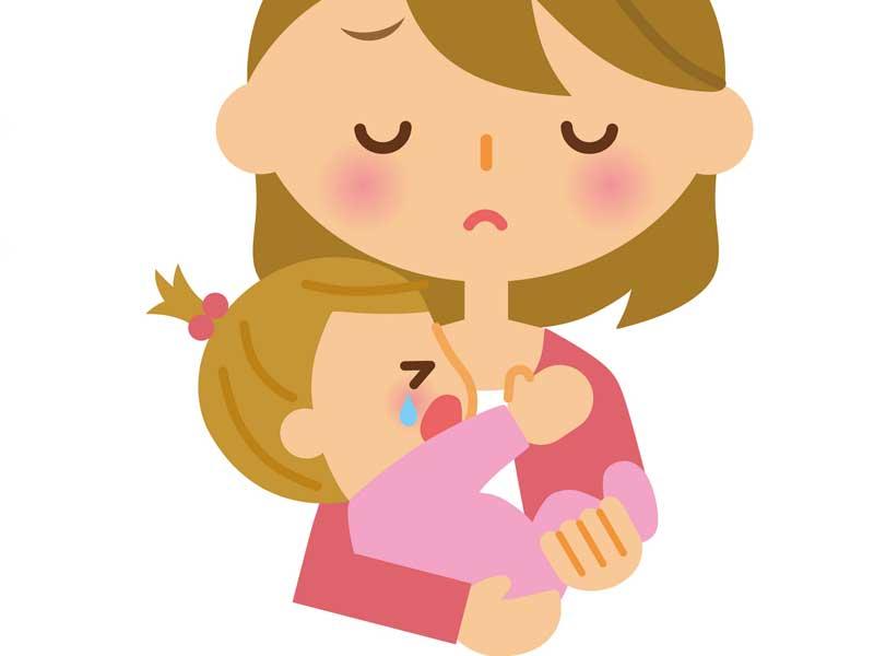 ママに抱っこされて泣いている赤ちゃん