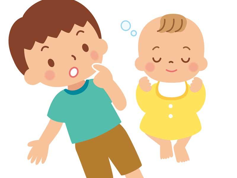 赤ちゃんを見ているお兄ちゃんのイラスト