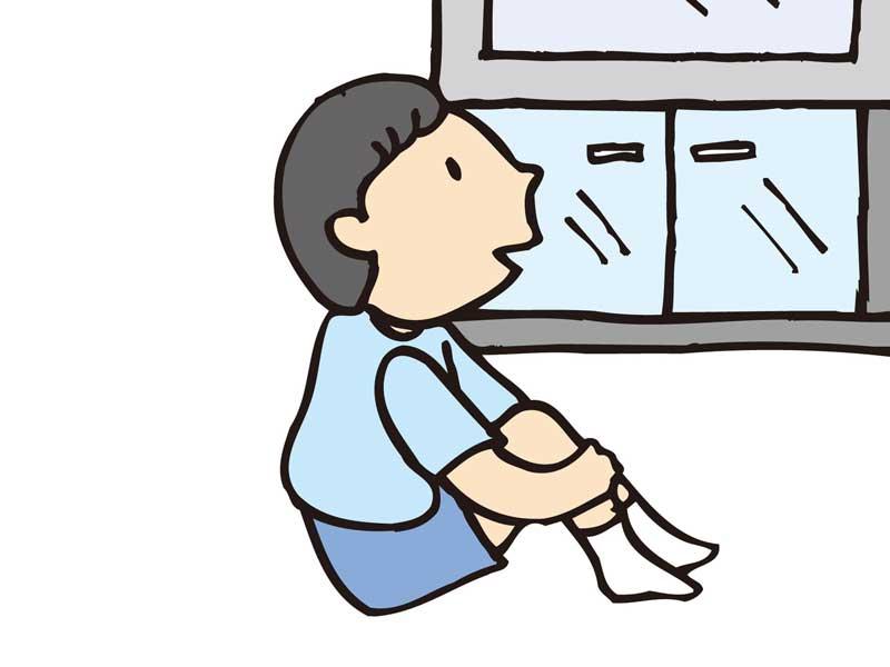 体育座りをしている子供のイラスト