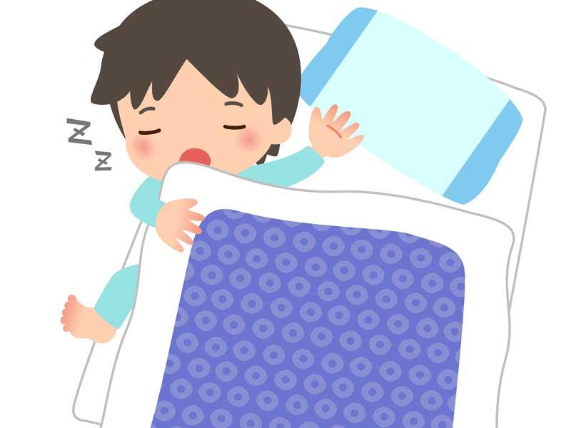 寝相が悪い男の子のイラスト