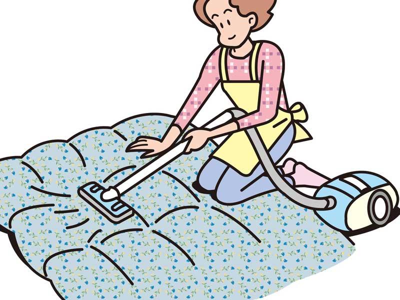 布団に掃除機をかけるお母さんのイラスト