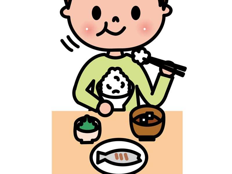食事をしている子供のイラスト