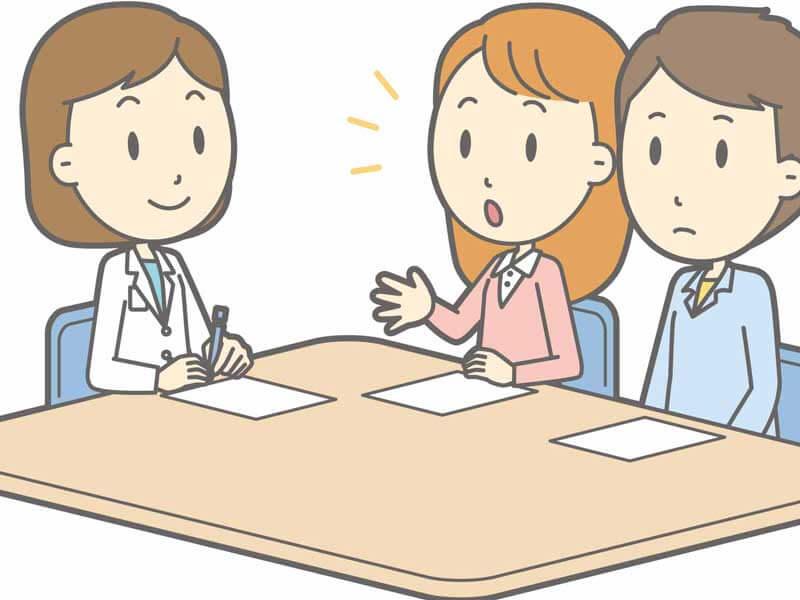 医師と相談する夫婦のイラスト