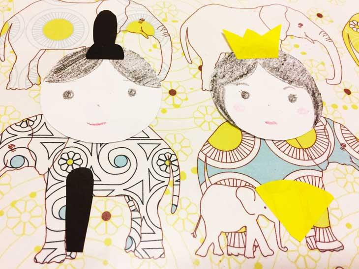 顔と髪を書き烏帽子と冠を貼った丸い白画用紙
