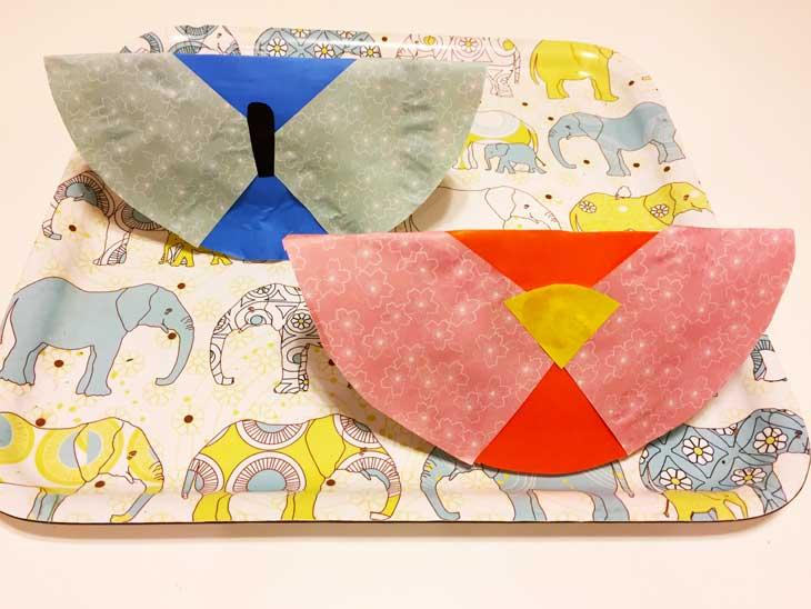 お雛様の体の部分を折り紙で飾った紙皿