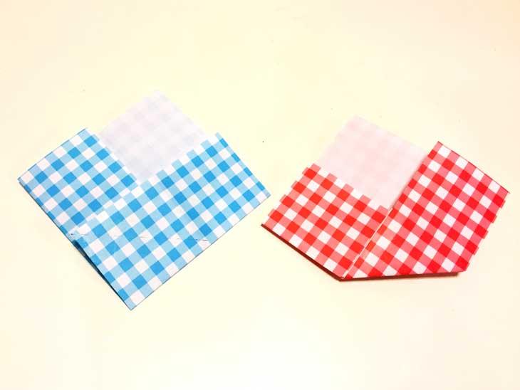作成途中に点線が描かれた折り紙のお雛様