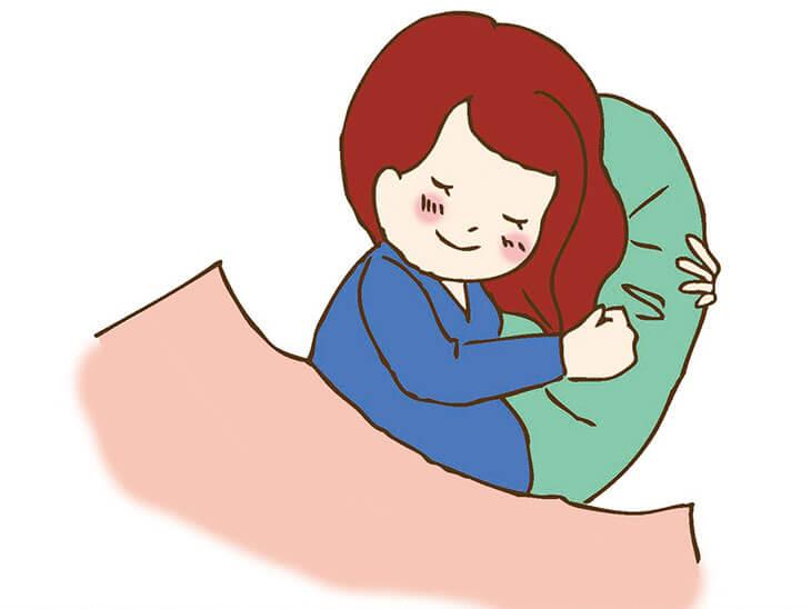十分な睡眠をとる妊婦