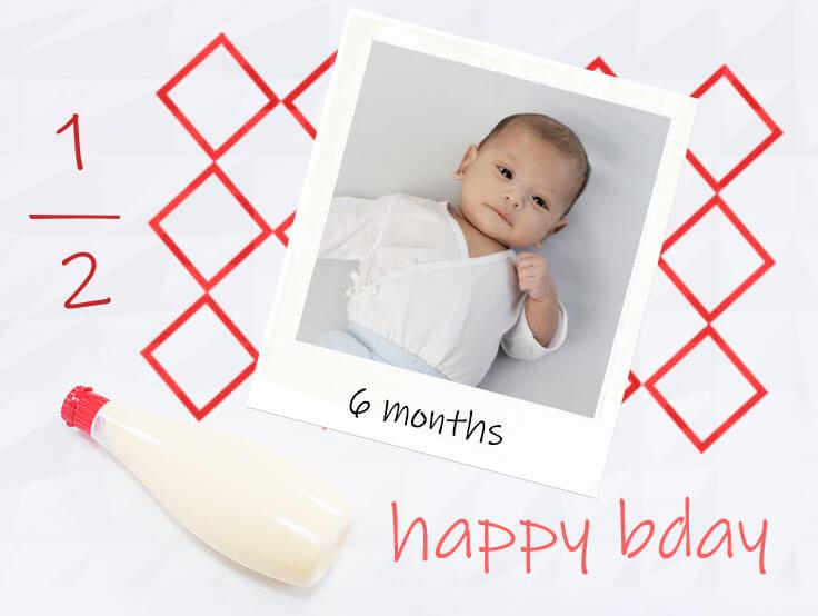 マヨネーズのキューピーハーフの飾りとハーフバースデーの赤ちゃんの写真