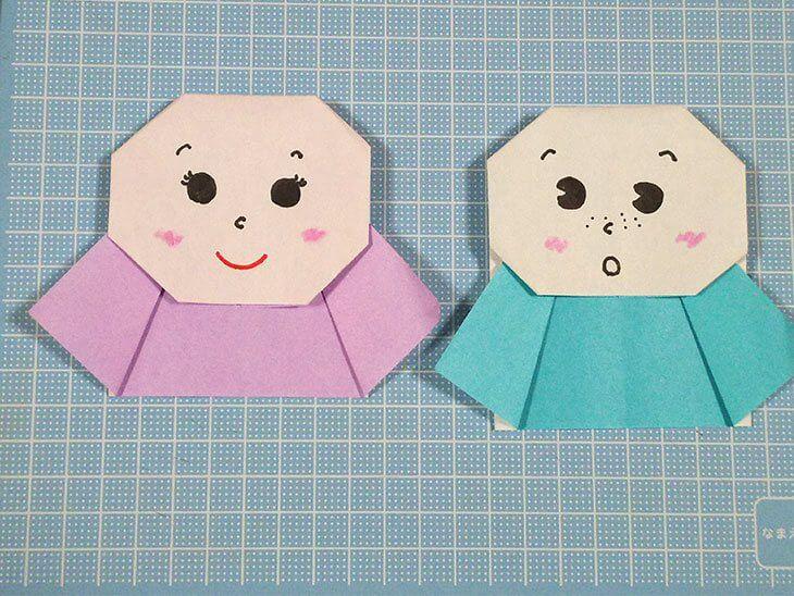 顔を描き入れた折り紙製てるてる坊主