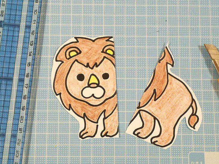 半分にカットした絵合わせカード用のライオンのイラスト
