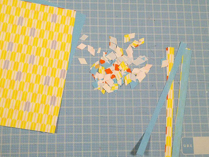 くす玉の中身に入れる紙ふぶきを作る様子