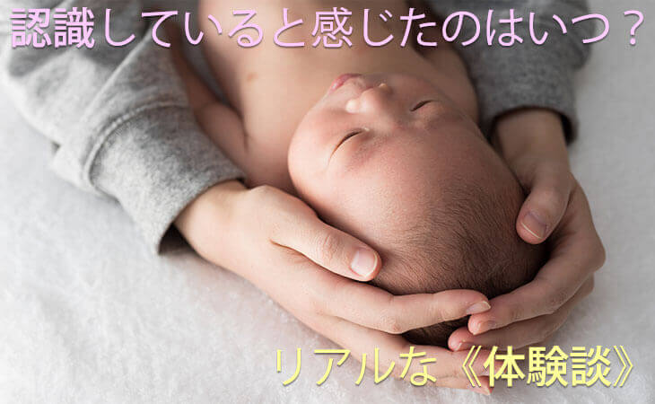 赤ちゃんを包み込むママの手