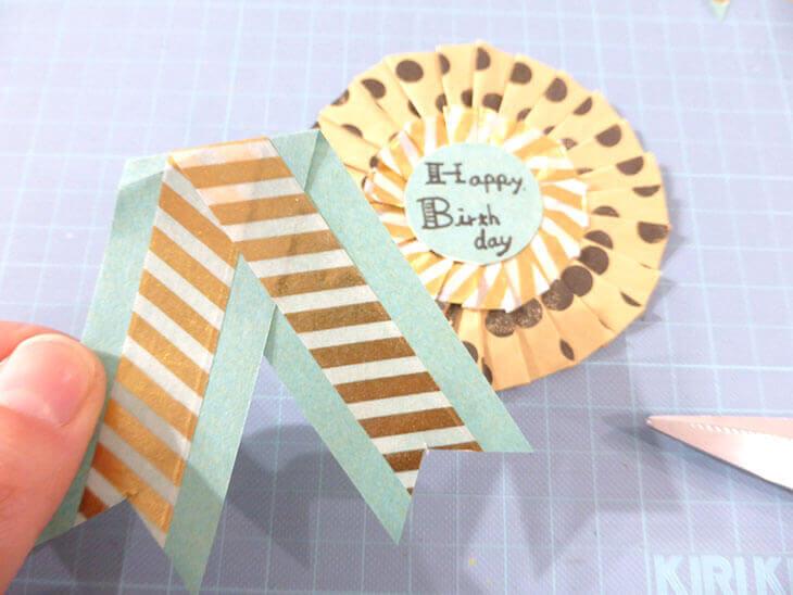 折り紙とマスキングテープで作ったリボンとロゼット台紙
