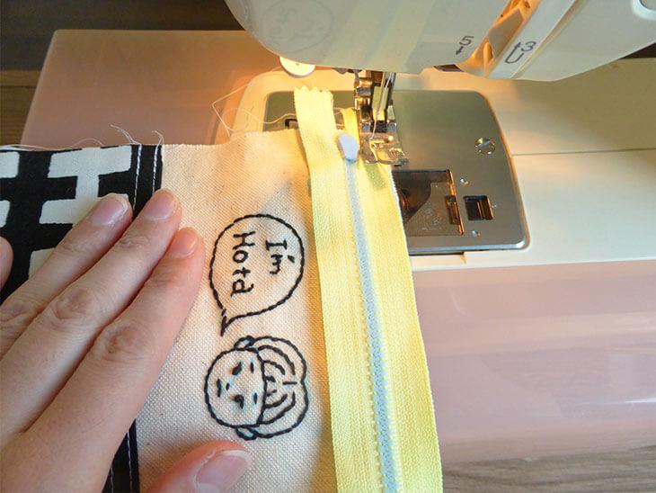 ファスナーを縫っている様子