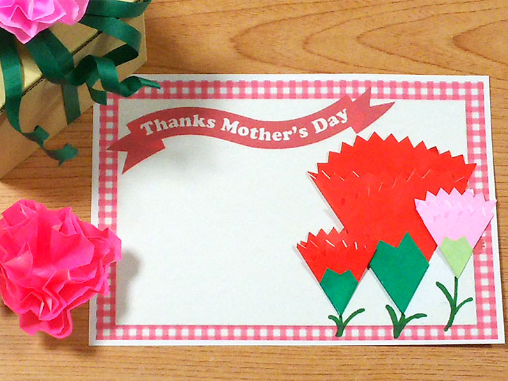 平面カーネーションの花を使ったメッセージカード
