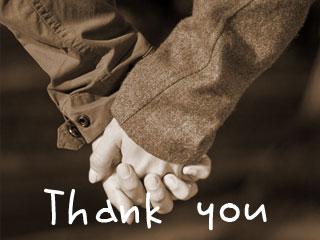 妻と夫が手を握っている