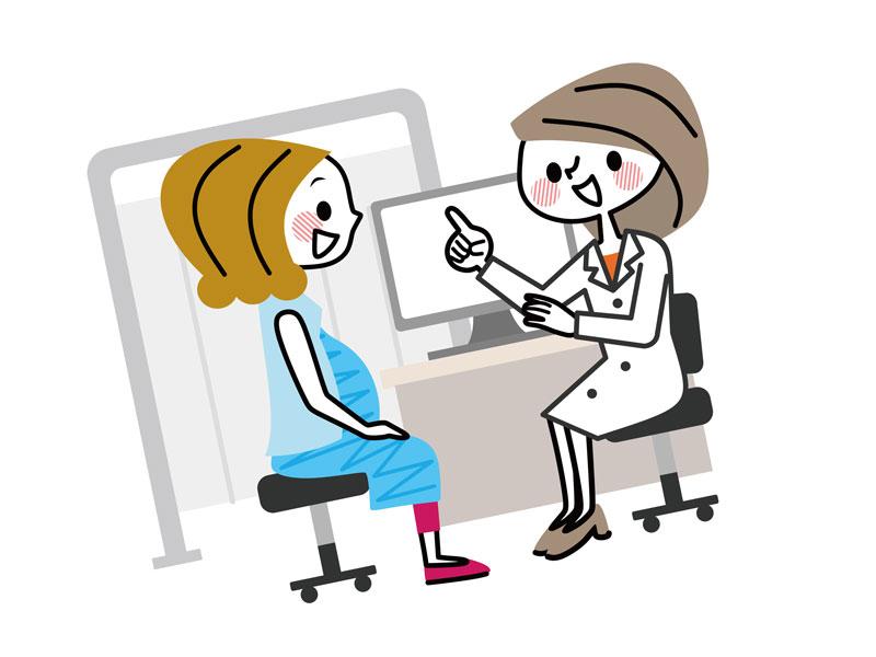 産婦人科女医と相談する妊婦さん