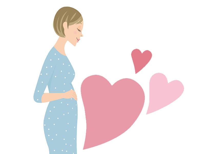 妊娠初期の女の人とハートのイラスト