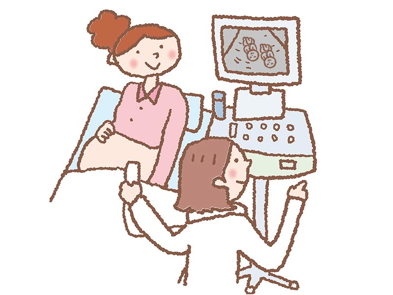 エコー検査を受けてモニターを見ている妊婦さんのイラスト