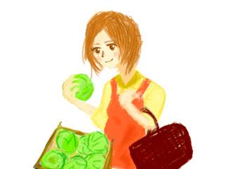 スーパーでキャベツを手にする主婦